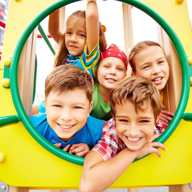 Image of joyful friends having fun on playground outdoors